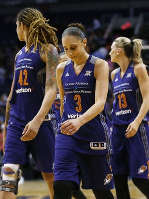 Phoenix Mercury Diana Taurasi walks-off the court dejected after losing to the Seattle Storm during the season opener in Phoenix, Ariz., on Friday, May 20, 2016.