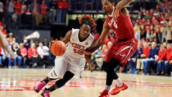 Jan 7, 2016; Oxford, MS, USA;  Mississippi Rebels guard Stefan Moody (42) drives to the basket against Alabama Crimson Tide guard Arthur Edwards (4) during the first half at The Pavilion at Ole Miss. Mandatory Credit: Spruce Derden-USA TODAY Sports