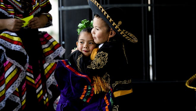 Mariah Hawley and Montez Sanchez hug before their performance with Gala de Ballet Folklorico at the 2015 Northern Colorado Cinco de Mayo Festival, Saturday, May 2, 2015. The afternoon consisted of dancing, games, and music.