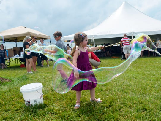 Matilda Johnsen, 4, and brother Hayden, 7, make bubbles