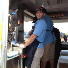 Rudi Sinykin, 34, of Gilbert, in one of the Kettle Heroes popcorn trucks. Sinykin, along with his brother, Aaron, founded the company.