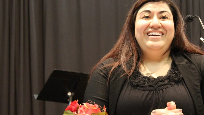 Grissell Castro laughs during her talk Tuesday night at a dinner for blood donors sponsored by the Hendrick Regional Blood Center. The platelet donor called out to a younger generation to donate. It was noted that guests at the event had accounted for 1,500 gallons on blood going into 2018.
