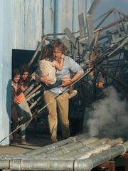 """In this image released by The Weinstein Company, Owen Wilson, right, and Lake Bell appear in a scene from, """"No Escape."""""""
