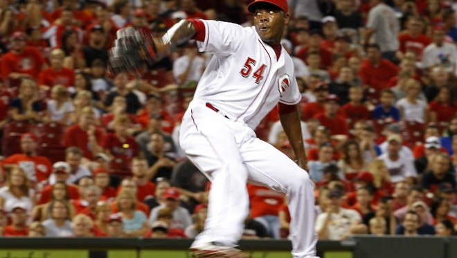Cincinnati Reds relief pitcher Aroldis Chapman (54) pitches in the ninth inning.