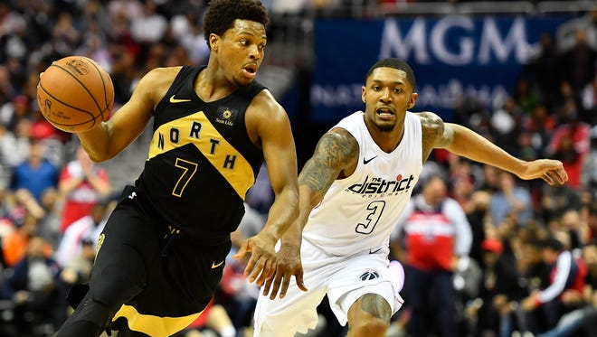 Toronto Raptors guard Kyle Lowry (7) dribbles as Washington Wizards guard Bradley Beal (3) defends during the second half in game six of the first round of the 2018 NBA Playoffs at Capital One Arena.