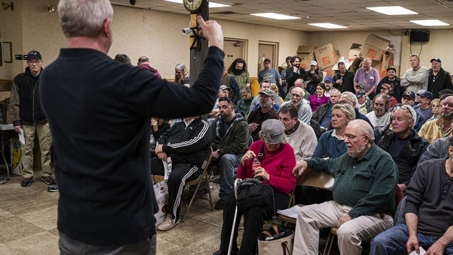 Wayne Tuiskula, of Central Mass Auctions, conducts the auction in Worcester where a sword once held by President Abraham Lincoln was up for grabs on January 30, 2020. The sword was presented by Lincoln to 1st Lt. John Wesley Jones in 1862 for his service commanding the White House Guard.