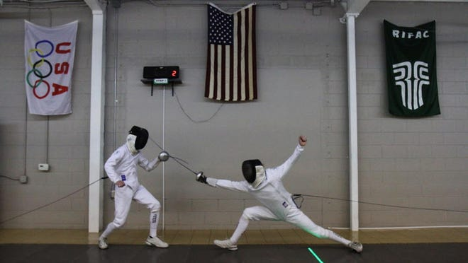 "Practice at the Rhode Island Fencing Academy.  Fencing may be ""a niche sport, but you'll notice that people from all different socio-economic and racial backgrounds are able to participate in the sport because of initiatives at the local level,"" says Barrington High freshman Anna Saal, who is among those protesting Brown's decision."