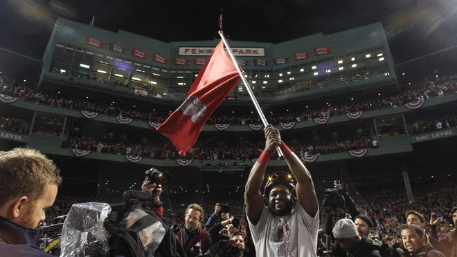 David Ortiz celebrates after winning the World Series at Fenway Park against the St. Louis Cardinals in 2013.