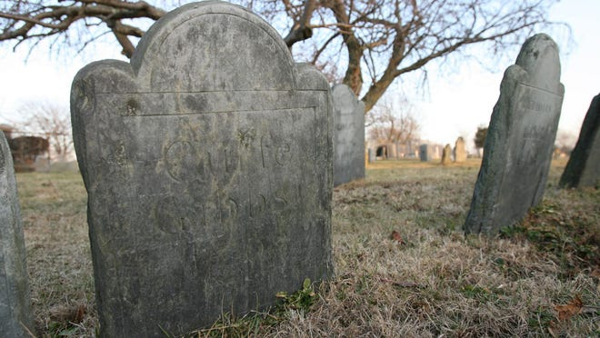 A grave stone in God's Little Acre in the Common Burial Ground in Newport.