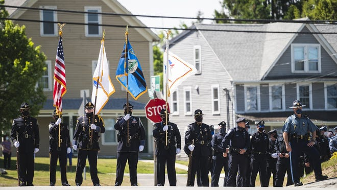 RUTLAND - Officers from various departments showed their support outside the funeral of police Detective John Songy at St. Patrick Parish on Thursday.