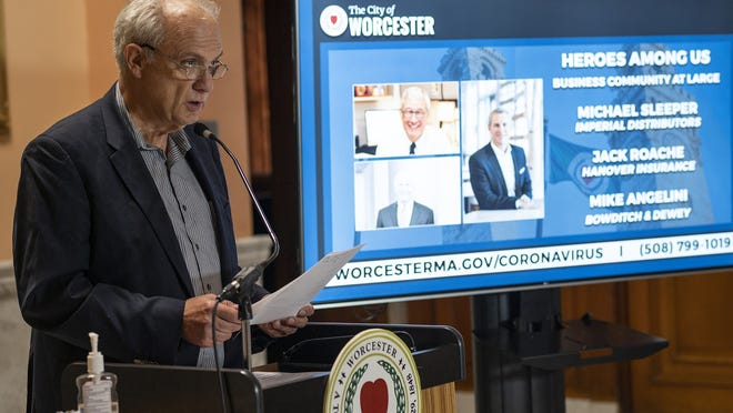 Mayor Joe Petty honors local business leaders Michael Sleeper, Jack Roache and Mike Angelini during the the city's COVID-19 briefing on Thursday.