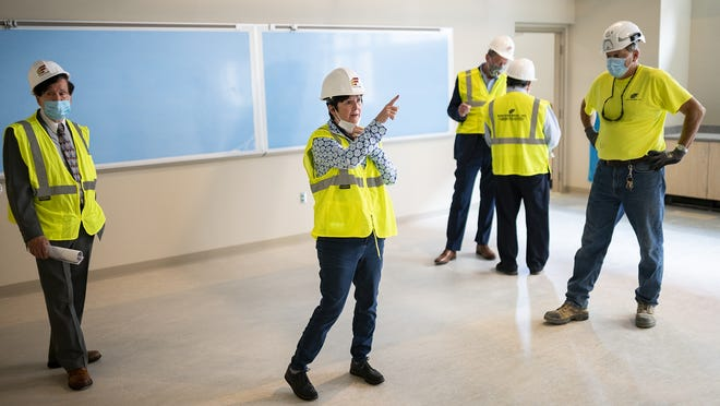 Superintendent Maureen Binienda shows off the science labs during a tour of the new South High school in Worcester Thursday.