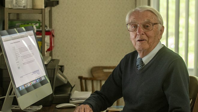 Retired Holy Cross professor James Flynn takes online WISE classes in his Worcester home Thursday.