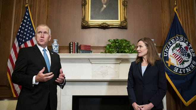 Sen. Thom Tillis, R-N.C., meets with Judge Amy Coney Barrett, President Donald Trump's nominee to the Supreme Court at the U.S. Capitol Wednesday in Washington.
