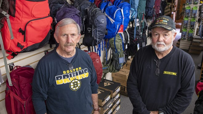 New England Backpacker owners Bill White, left, and Wayne Ridley are closing the store in Worcester after 43 years.