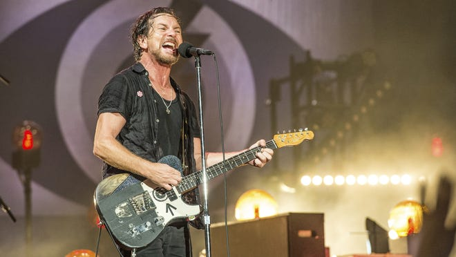 Eddie Vedder of Pearl Jam performs at Bonnaroo Music and Arts Festival in Manchester, Tenn. on June 11, 2016. Pearl Jam has encouraged fans to vote and asks them to take a pledge to try and mail-in their ballots.
