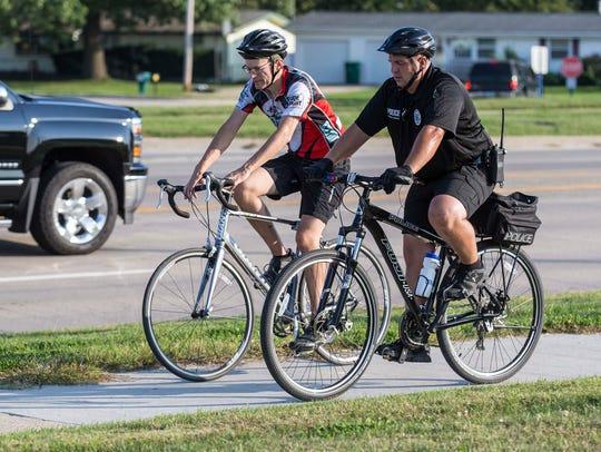 Register columnist Kyle Munson rides with Norwalk officer