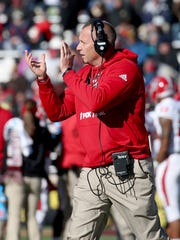 North Carolina State head coach Dave Doeren encourages his team during a timeout in the first half of an NCAA college football game against Boston College, Saturday, Nov. 11, 2017, in Boston. (AP Photo/Mary Schwalm)