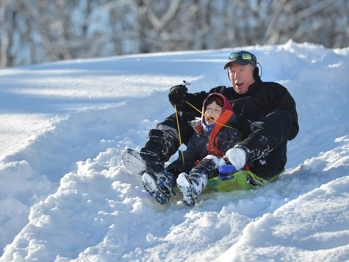 Jay Fitzgerald and his son Jack, 6, of White Lake,