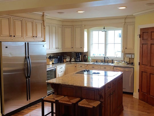 The kitchen is large with top-of-the line appliances.