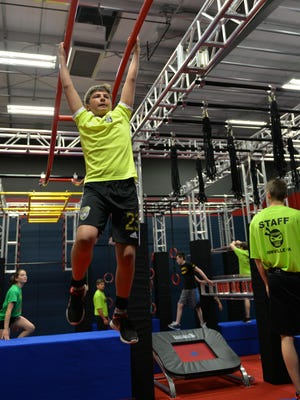 MacRae Plummer demonstrates his skill on the Ninja Warrior training course based on NBC's American Ninja Warrior TM at the Paramount Sports Complex Inc., located in Annville on April 23, 2016.
