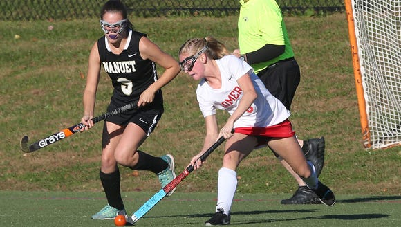 Somers' Caitlin Spor (3) fires a shot in front of Nanuet's