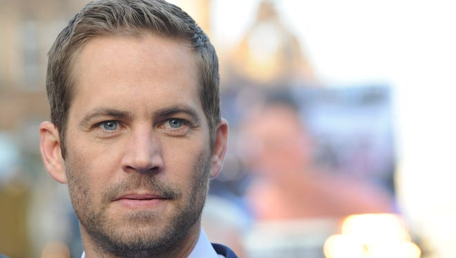 """Actor Paul Walker at the """"Fast & Furious 6"""" World Premiere at The Empire, Leicester Square on May 7, 2013 in London. Investigators concluded that the November 30 car crash that killed the actor was caused by high speed, not mechanical problems."""