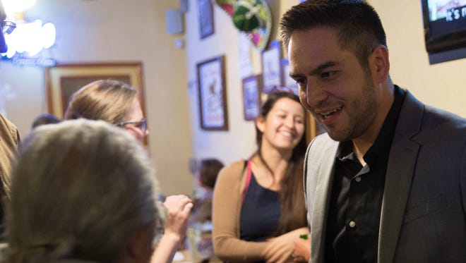 Gabriel Vasquez, Las Cruces city council candidate for district 3 greets current city councilor for district 3 ,Olga Pedroza, at his election night watch party at Las Trancas Restaurant. Tuesday, November 7, 2017.