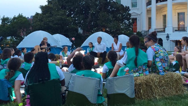 Forty-four high school juniors in Girl Scouts, including two local girls,  met President Barack Obama and First Lady Michelle Obama and camped out at the White House on Tuesday.