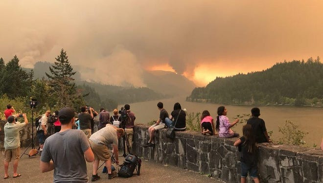 Onlookers watch the Eagle Creek Fire Monday, September 4.