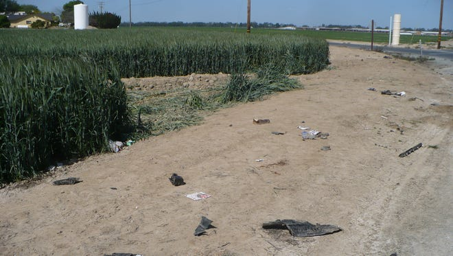 Debris from a drunken crash that killed a child and her grandmother near Tulare.