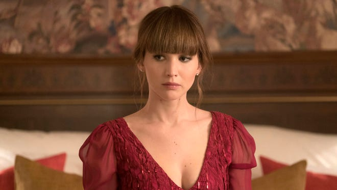 """In this image released by Twentieth Century Fox, Jennifer Lawrence appears in a scene from """"Red Sparrow."""" (Murray Close/Twentieth Century Fox via AP)"""