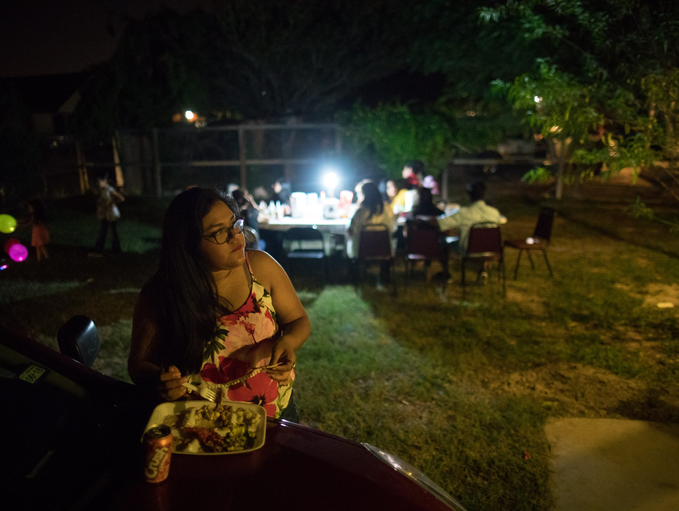 Maria Hernandez finds a quiet moment to eat after making