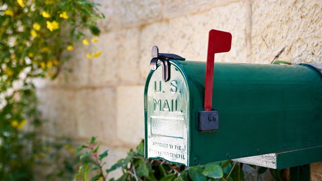Green mailbox with flag up.