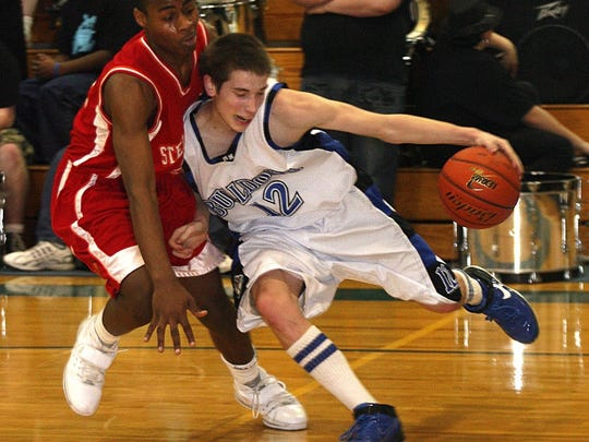 Brett Skogstad drives against a player from Steilacoom