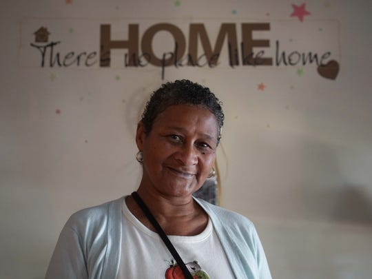 """Venise Winchester, has been living in the Ministry of Caring's new Sacred Heart Village II complex for low-income elderly residents since May and she says """"there's no place like home."""""""