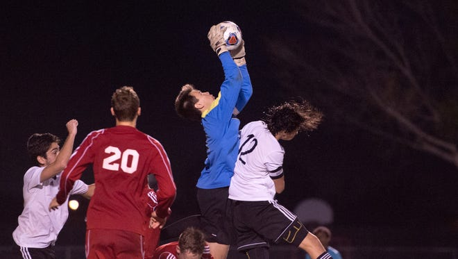 Vero Beach goalkeeper Wesley Alexander is shown making a save in a boys soccer region final game against Douglas High School in February. Vero Beach won the game 2-1 to advance to the FHSAA state finals.