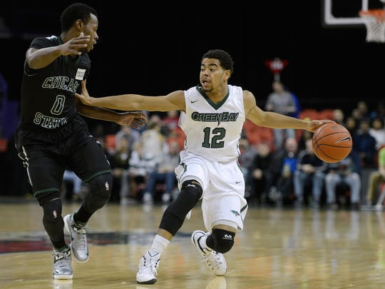 UW-Green Bay guard Carrington Love creates space between himself and Chicago State guard Sean Hill in the first half at the Resch Center on Wednesday, Dec. 31, 2014.