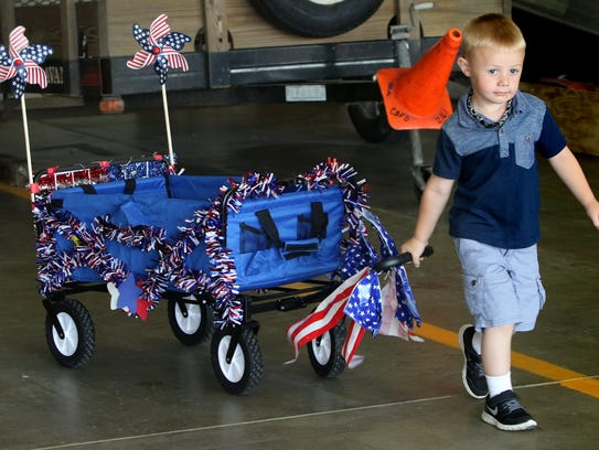 Treyton Schreurs, 4, pulls his family's creation out