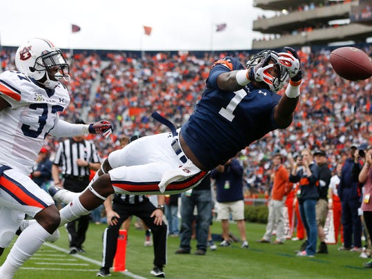 Auburn wide receiver Trovon Reed (1) cannot make the catch as Auburn defensive back Kamryn Melton (37) defends in the first half of the annual A Day spring intrasquad NCAA college football game on Saturday, April 19, 2014, in Auburn, Ala. (AP Photo/John Bazemore)