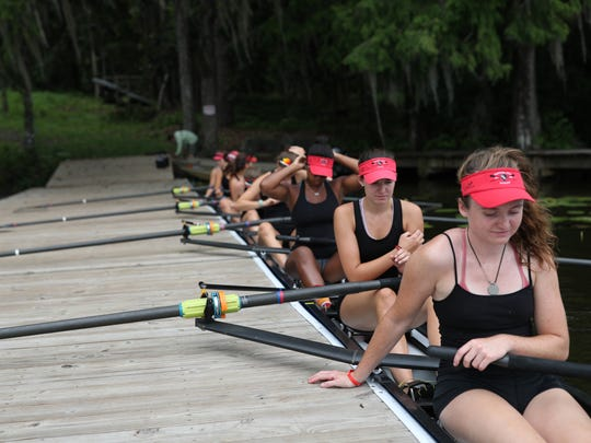 Laura Reeves, front, and Maya Edwards, second in line, join their Capital City Rowing teammates as they prepare their boat for training on Lake Talquin Wednesday, May 30, 2018 ahead of their trip to the U.S. Rowing Youth Nationals in California, where they will compete with the top youth rowers from around the county.