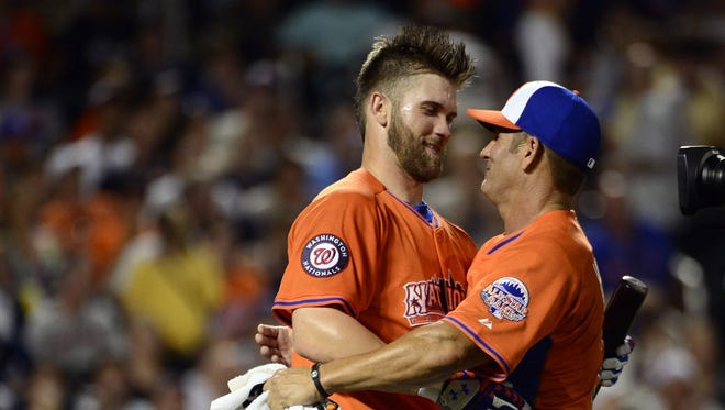 Bryce Harper's father, Ron, threw to him in the 2013 Home Run Derby, but recently had rotator cuff surgery, so he wouldn't be able to throw to him at the Home Run Derby in Cincinnati.