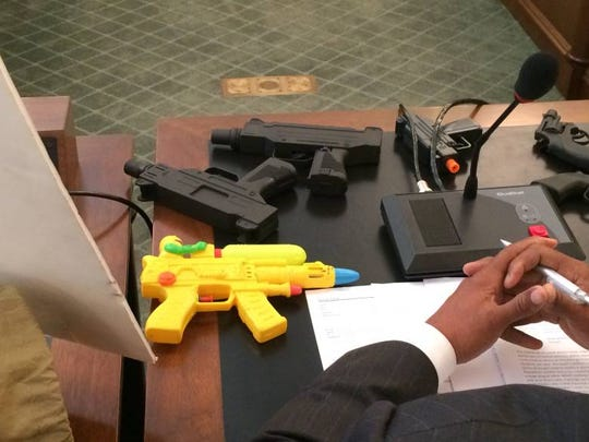 East Orange Council President Ted Green brought a collection of toys guns to a legislative hearing Thursday in Trenton.