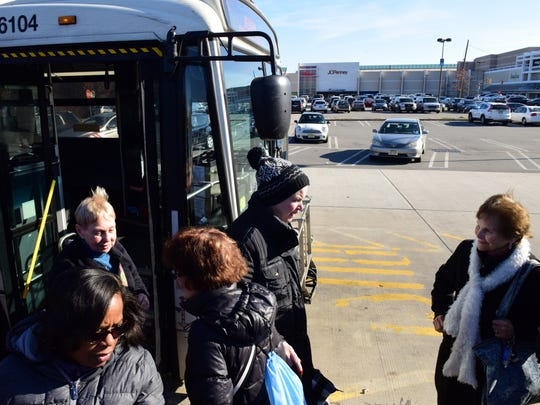 A group of senior citizens get off the 756 NJ Transit bus at the Garden State Plaza mall Tuesday morning.