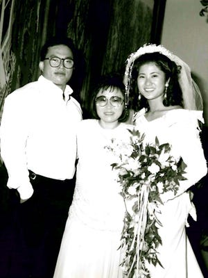 Kim Duenas, center, with her children, Joe and Ann, in a 1992 photo.