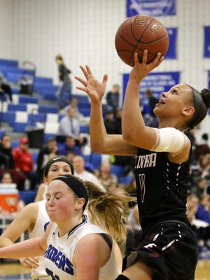 Kiara Fisher of Elmira goes up for a shot against Horseheads on Tuesday at Horseheads Middle School.