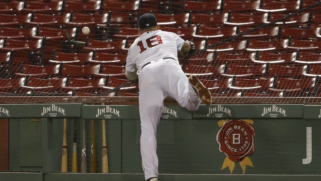 Boston first baseman Mitch Moreland can't get to a foul ball during the third inning of Tuesday's game.