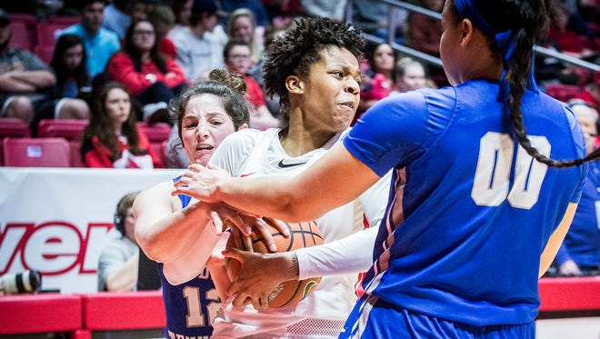 Ball State's Destiny Washington fights past past Middle Tennessee's defense during their game at Worthen Arena Thursday, March 15, 2018. .