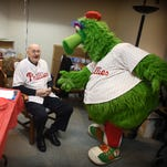If you 're a Phillies fan, what better way to celebrate your 100th birthday than with the Phillie Phanatic? Lester Shenk of Myerstown did just that, surrounded by his three children, son, Larry Shenk, and daughters, Corinne Krall, and Rochelle Ebling. Shenk turned 100 on Jan 7.