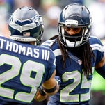 Dec 28, 2014; Seattle, WA, USA; Seattle Seahawks cornerback Richard Sherman (25) shakes hands with Seattle Seahawks free safety Earl Thomas (29) during pre game warmups against the St. Louis Rams at CenturyLink Field.
